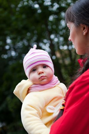 Baby with mom outdoors - shallow DOF photo