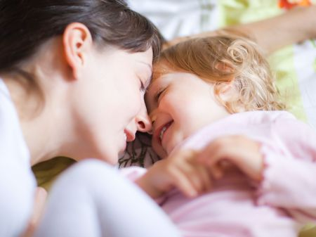 Happy mother with a child - shallow DOF, focus on eyes photo