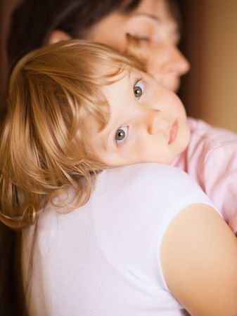 Little child with mom - shallow DOF, focus on eyes photo