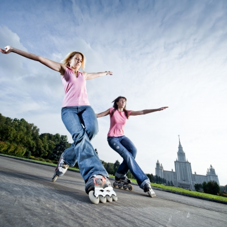 inline skates: Wide angle photo of twin acid-wheeling slide - little motion blur