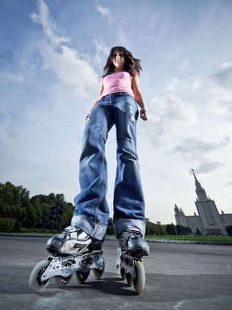 inline skates: Wide-angle shot of a standing rollerblading girl Stock Photo
