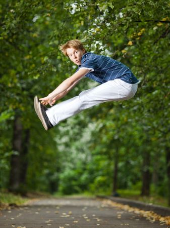 plasticity: Jumping man in a park alley - shallow DOF and little motion blur