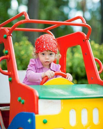 shallow dof: Little girl in a toy car cabin - shallow DOF