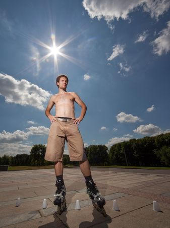 Wide angle portrait of a rollerskater under hot sun photo