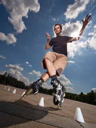 inline skates: Wide angle portrait of a training rollerskater