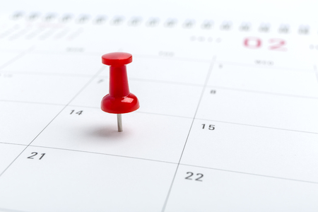 white pushpin: Concept image of a Calendar with a red push pin. Closeup shot of a thumbtack attached. The words heart shape written on a white notebook to remind you an important appointment.