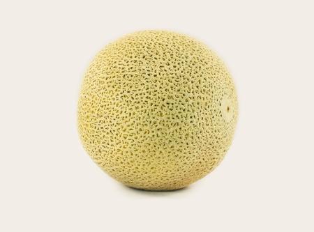 Single firm whole ripe unpeeled uncut cantaloupe.