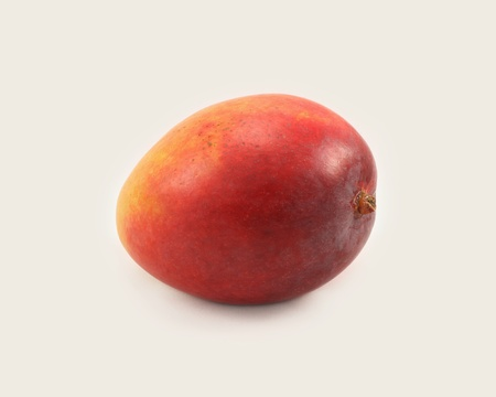 Single ripe unpeeled uncut sweet Haden mango Stock Photo - 9792383