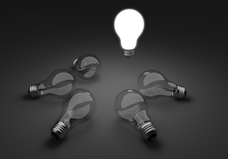 epiphany: Five clear light bulbs in a circle, one illuminated standing out from the group Stock Photo