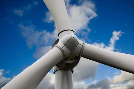 Giant Wind Turbine with blue sky background photo