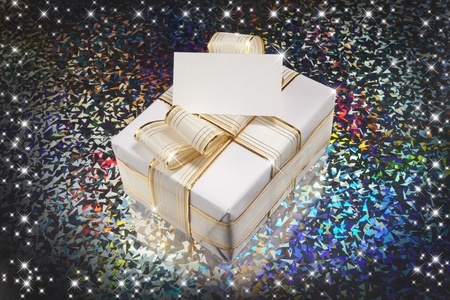 Christmas gift and stars with colorful backgraun Stock Photo - 8305643