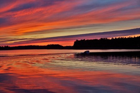 Motoboat in sunset photo