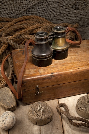 Antique binoculars on old wooden box Stock Photo