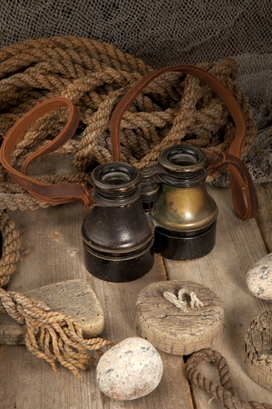 Antique binoculars on old wood  Stock Photo - 8531342