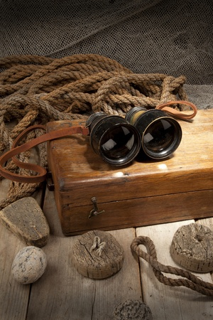 Antique binoculars on old wooden box Stock Photo - 8531340