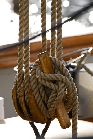 Old wooden block with rope. Stock Photo - 8864283