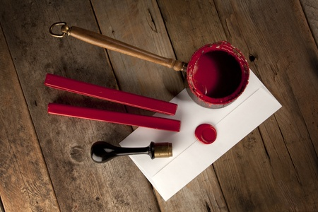 Red wax staff with stamp, pot and letter