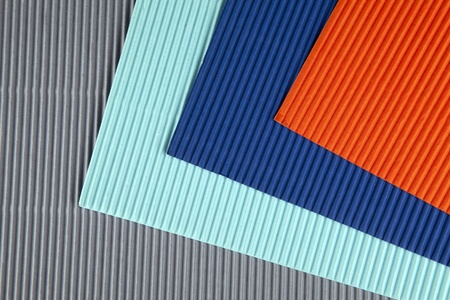 Background of colored corrugated cardboard with shadow Stock Photo