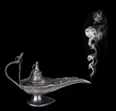 Genie lamp with a smoke - symbol of the rapid success. Isolated on black