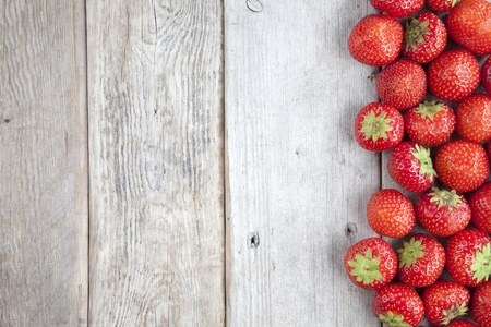 Fresh strawberries on old wooden background Stock Photo - 10383155
