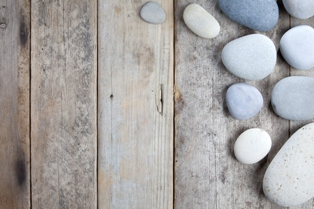 Stones with shadow on wooden background Stock Photo - 10427263