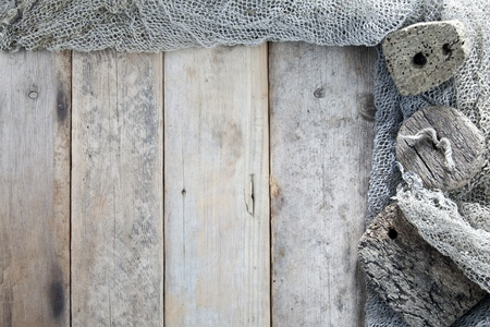 Cork, fishing net and rope with wooden background Stock Photo - 10427266