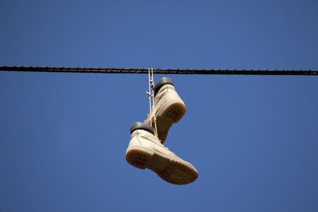 Shoes hanging high on wire Stock Photo - 10763710