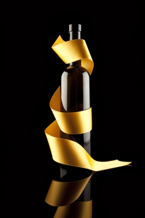 Gold ribbons around bottles photo