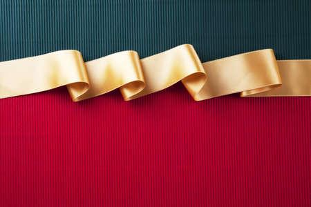 Gold ribbon banner on corrugated cardboard