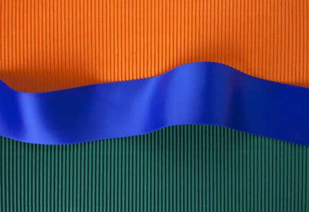 Blue ribbon banner on corrugated cardboard photo