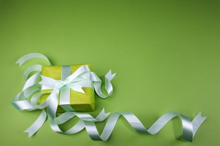 Gift box with ribbon on green background  Stock Photo
