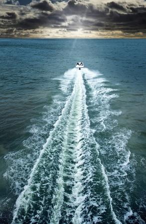 Speedboat cruising in the sea Stock Photo