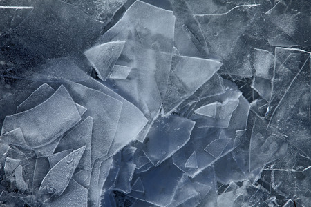 Cracked blue ice on frozen water Stock Photo