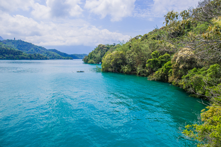 The beauty of the Sun Moon Lake is the calm, turquoise water complemented by the majestic mountains that surround the lake.