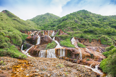The Golden Waterfall is a waterfall near the popular tourist village Jiufen and the Gold Ecological Park, Taiwan.