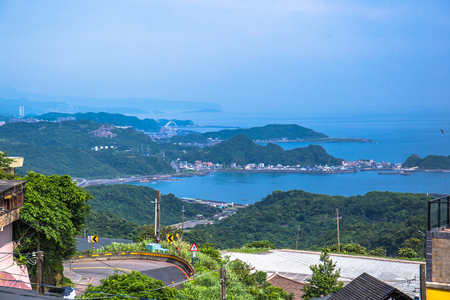 Panoramic aerial View of Jiufen with Keelung port and Sea from jiufen old street Stock Photo