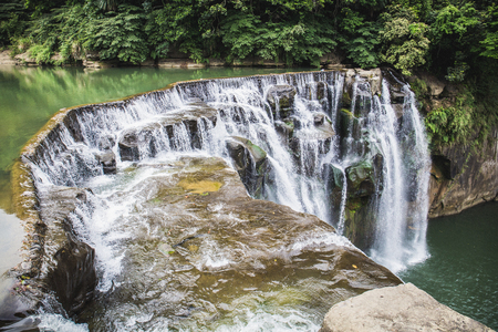 Shifen Waterfall is a scenic waterfall located in Pingxi District, New Taipei City, Taiwan, on the upper reaches of the Keelung River. Reklamní fotografie