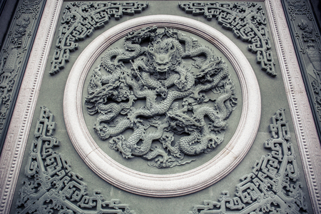 Beautiful dragon walls sculptures and decorative plaques at Wenwu Temple