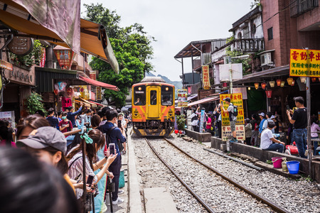 Shifen, Taiwan - June 4, 2018: Shifen old street is one of the most popular tourist attraction where thousands of people flock to the area for releasing the sky lantern with written prayers on it.