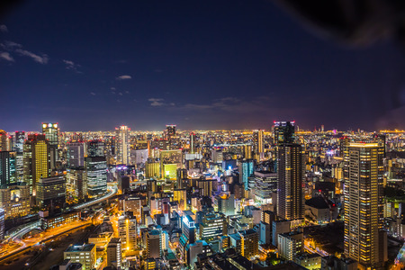 Osaka, Japan - November 19, 2018: Aerial view of the Osaka cityscape at night from the observation platform at the Umeda sky building.