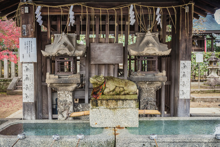 Kyoto, Japan - November 23, 2018: A purification fountain called the chozuya, is where you purify yourself by cleaning your body and mind before visiting the shrine. Editorial