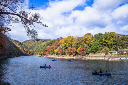 Kyoto, Japan - November 23, 2018: Arashiyama and Katsura river is the famous destination for tourist in autumn of japan. Many tourists come to see the beautiful autumn colors near the river. Editorial