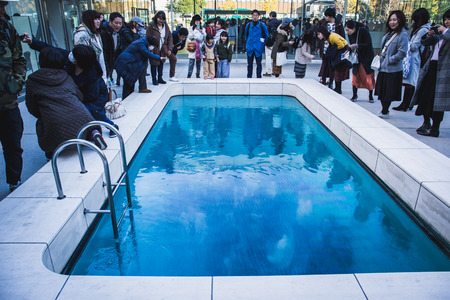 Kanazawa, Japan - November 24, 2018: The famous art installation at the museum, Leandro Erlichs Swimming Pool. Its an illusory swimming pool that seems to be filled with water.