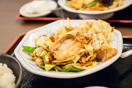 Chinese style stir fried pork with cabbage and rice set served at a Japanese restaurant at Tokyo. Reklamní fotografie