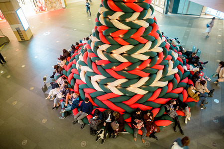Tokyo, Japan - November 30, 2018: The entire Christmas tree are made from soft and stretchy knitted fabric, visitors can sit and lie down on this Christmas tree at Roppongi Hills 報道画像