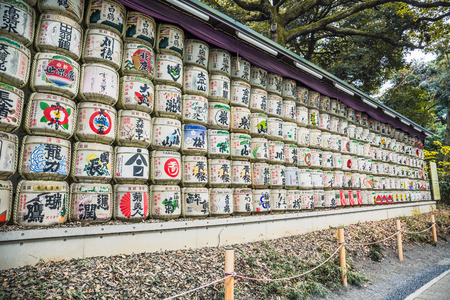 Tokyo, Japan - December 2, 2018: Barrels of Sake (Nihonshu) wrapped in staw at Meiji Jingu Shrine