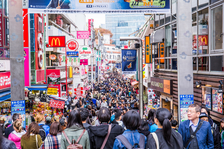 Tokyo, Japan - December 2, 2018:  Takeshita Dori is a narrow, roughly 400 meter long street lined by shops, boutiques, cafes and fast food outlets targeting Tokyos teenagers.