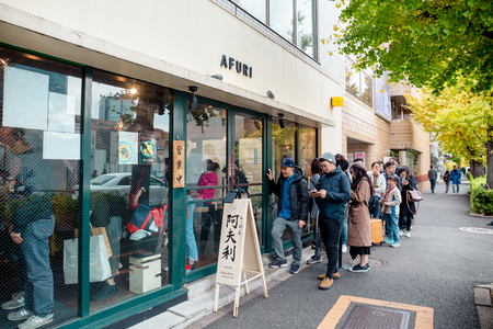 Tokyo, Japan - December 2, 2018: A long queue of people waiting at the Ramen restaurant called Afuri for their famous signature dish – Yuzu ramen.