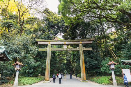 Tokyo, Japan - December 2, 2018: The huge wooden Torii gate leading to Meiji Jingu shrine Redakční