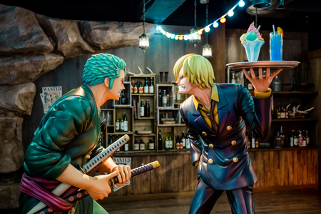 Tokyo, Japan - December 3, 2018: One piece statue of Zoro the swordsman and Sanji the cook fiberglass mascot in human size set up to display at Tokyo Onepiece Tower.